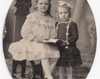 Old Photo 2 Girls wearing Dresses with Book 1910s Photograph snapshot vintage