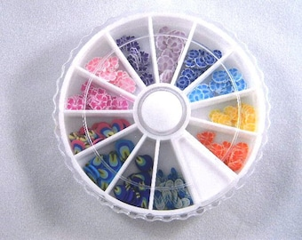 Hibiscus and Feather Fimo Cane Slice Nail Art Wheel