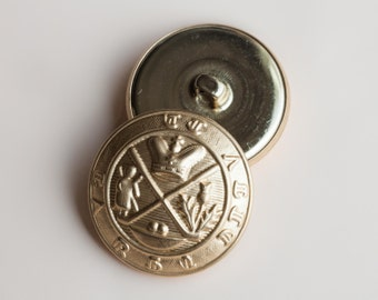 "5 Vintage 1 1/16"" Gold Tone Metal Shank Buttons with a Detailed Crest Design. Mildly Domed. Item 0335M"