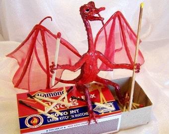 Red Dragon Firebug: Lighting up matches - Dragon Art Doll