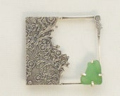 Solid Sterling Silver Brooch with etched flower design and claw-set found green  sea glass
