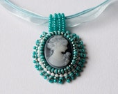 Bead embroidery cameo pendant whit a woman