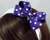 Hair bow 5 in. Purple polka dot bow on 1 in. white cloth headband
