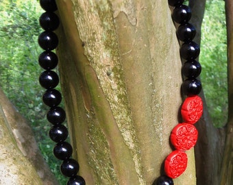 Black Bead and Red Carved Side Accents...