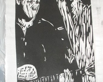 black and white linocut print guitar player