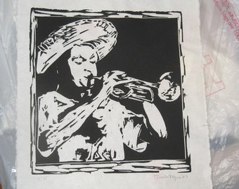 black and white linocut print trumpet player