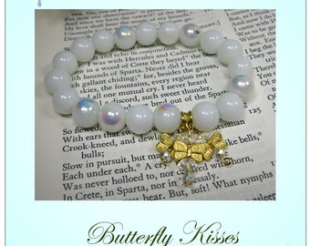 White Glass Bead and Butterfly Charm Bracelet, will compliment just about any outfit