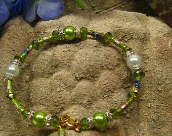 Going Green Bracelet with bright lime green glass pearls, cloisonne and crystals and silver crystal spacers