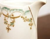Vintage ceramic pitcher - white with teal and gold trim