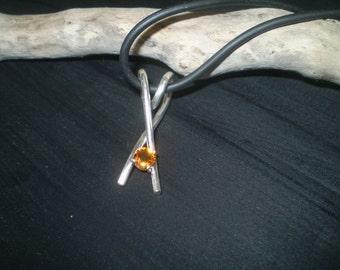 Handmade spessatite garnet cross-over sterling silver pendant