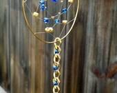 Dream catcher with blue glass and gold metal beads. Vegan Friendly. Modern dreamcatcher.