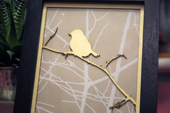Framed art. Laser cut bird on a branch with vintage wallpaper in a black frame