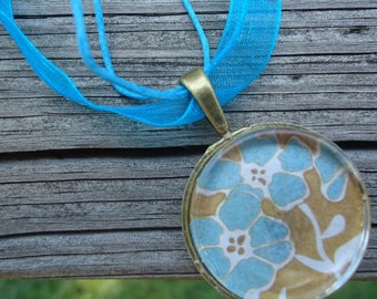 Blue Tan Flower Glass Pendant on Metal Bezel