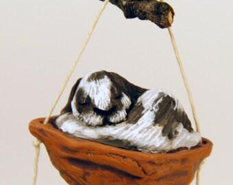Sleeping lop eared rabbit ornament