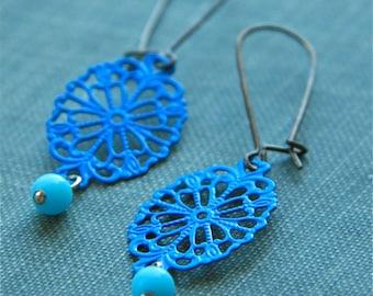 cobalt & powder blue doily earrings (metal filigree. blue glass. antique brass wire)