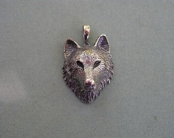 Sterling Silver Timber Wolf Pendant With Black Eyes