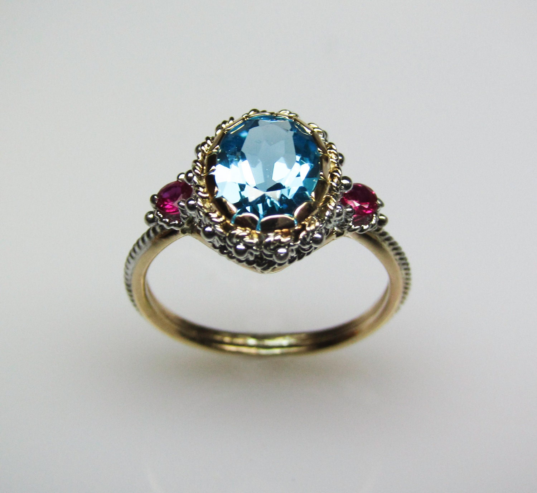 Blue Topaz Amp Ruby Ring In 14k Gold