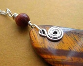 https://www.etsy.com/ie/listing/50291404/sale-red-tiger-eye-pendant-sterling?ref=shop_home_active_2