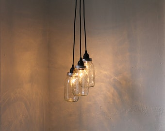Mason Jar Chandelier - Upcycled Hanging Mason Jar Pendants Lighting Fixture Featuring 3 Clear Quart Jars and Black Cords - BootsNGus Lamps
