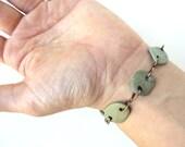 Natural green river stone bracelet on antiqued copper.