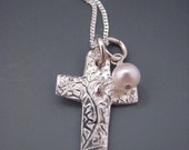 I believe Cross Charm Necklace with pearl