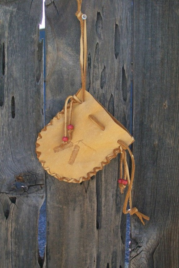 Buckskin drawstring pouch with burned feathers ,  Leather medicine bag