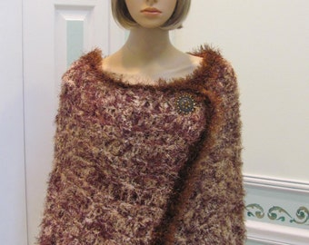 WARM KNIT CAPE: Designer Cape, extra large, in an imported, bulky weight yarn in shades of brown and beige,trim with cocoa brown fun fur