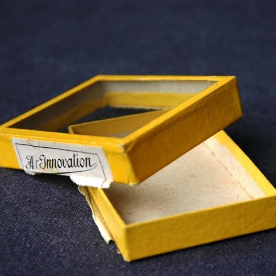 The mini yellow pocket shadow box