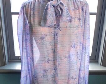 Cult status... Vintage billowy mod print Ascot blouse