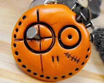 Orange round skull spiked with real nails. Brooch, keychain, pendant or magnet (you choose)
