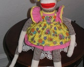 Sunny the SOCK MONKEY in her pink and yellow Dress