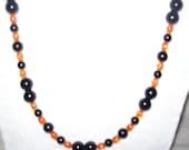 Orange Sunburst and Blackstone Necklace