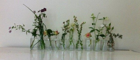 SUMMER CELEBRATIONS. Eleven recycled glass specimen vases .Great for weddings resturants.
