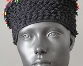 Black Crochet Hat with a Little Orangy Tuft...