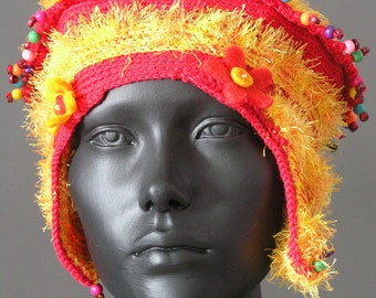 Orangy Yellow Beautiful Crochet Hat with an Orange Flower and Colourful Wooden Beads....