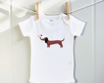 Valentines baby clothes, dachshund chasing hearts baby bodysuit