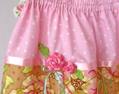 Pink, lime, and brown floral girls skirt with flower corsage.