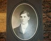 Vintage Photograph of a Solemn Young Man Cabinet Card