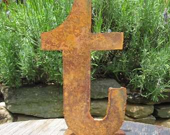 "Lowercase metal letter ""t"" on stand"