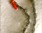 Fun Earring/chain with a gold wire wrapped red coral & chain. 18 K gold ear-hook.