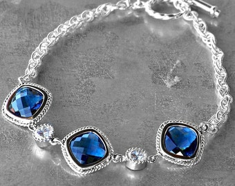 Faceted Sapphire Blue Crystals Set in Silver with Accent CZs on a Silver Bracelet