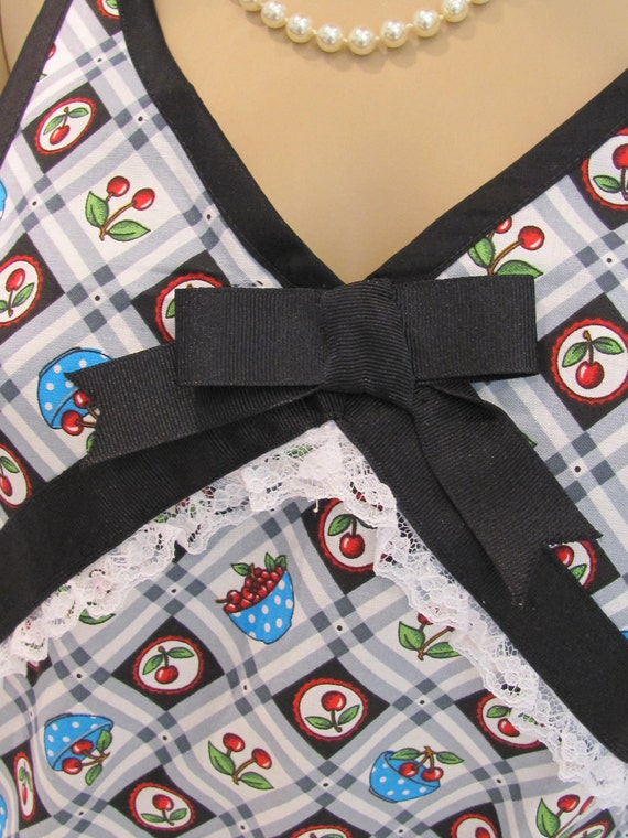 HANDMADE Sexy  full, apron , modern style ,sassy in a turquoise ,black and red cherry motif. ,with a dish towel included