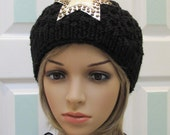 Black cloche hat, hand knitted, with a leather silver star, studded in brass