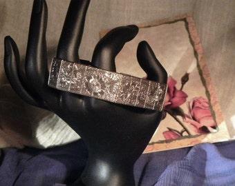 Sarah Cov Embossed Panel Bracelet Goldtone Fold Over Clasp Floral Design