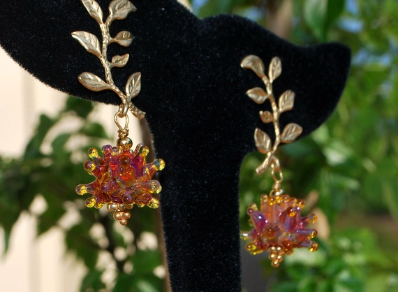 Amber lampwork berry gold leaved earrings
