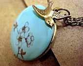 Turquoise enameled locket necklace with cherry blossom branch, long necklace and bronze swallow