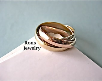 Heavy Tri-Gold, 14K, Three Band, Rolling, Puzzle Ring, Round with Smooth Finish.