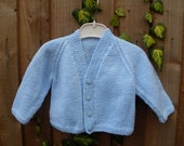 Hand knitted traditional baby boys blue V neck long sleeve cardigan Jacket Sweater.  (to fit approx. 9-12 months)