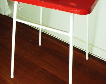 Jaunty Red Stool. Cheerfully rescued little vintage stool / table with enamel red top and white metal legs.