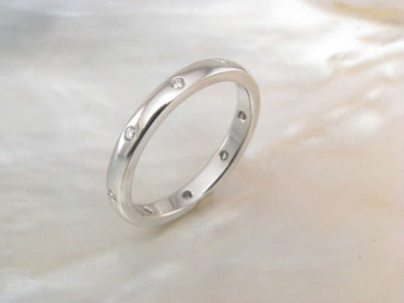handmade platinum wedding ring with scattered flush set diamonds, 2.5mm half round wedding band